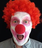 Close-up portrait of a young man dressed as a clown