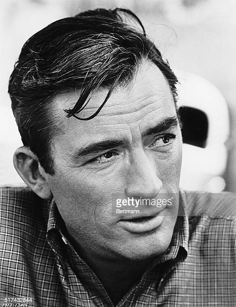 A closeup portrait of actor Gregory Peck He looks towards the side of the camera and wears a plaid shirt Undated photograph