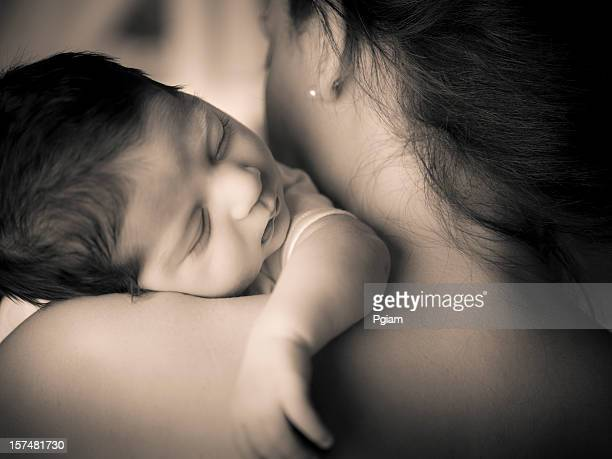 Closeup portrait of adorable baby with mom