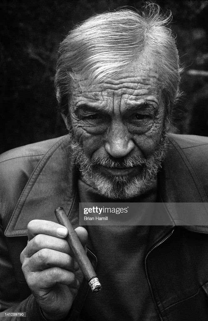 Close-up portrait of American film director (and occasional actor) John Huston (1906 - 1987) as he poses with a cigar in his hand in the Pacific Palisades neighborhood of Los Angeles, California, 1973.