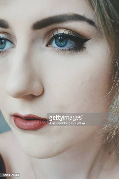 Close-Up Portrait Of Beautiful Woman Looking Away