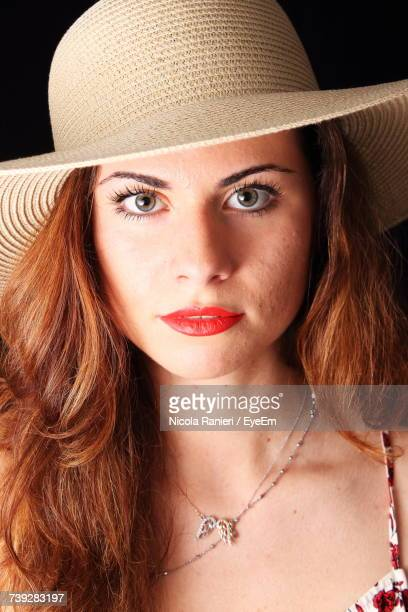 Close-Up Portrait Of Beautiful Woman Wearing Sun Hat