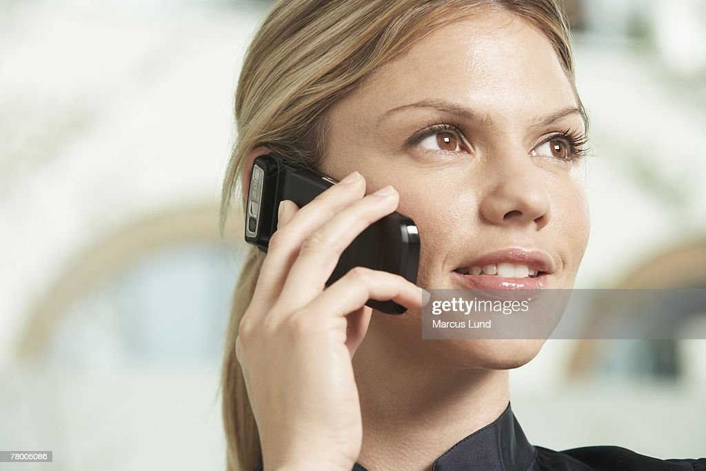 Close-Up portrait of Business woman using mobile phone. : Stock Photo