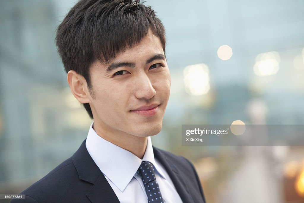 Close-up portrait of confident young businessman, China : Stock Photo