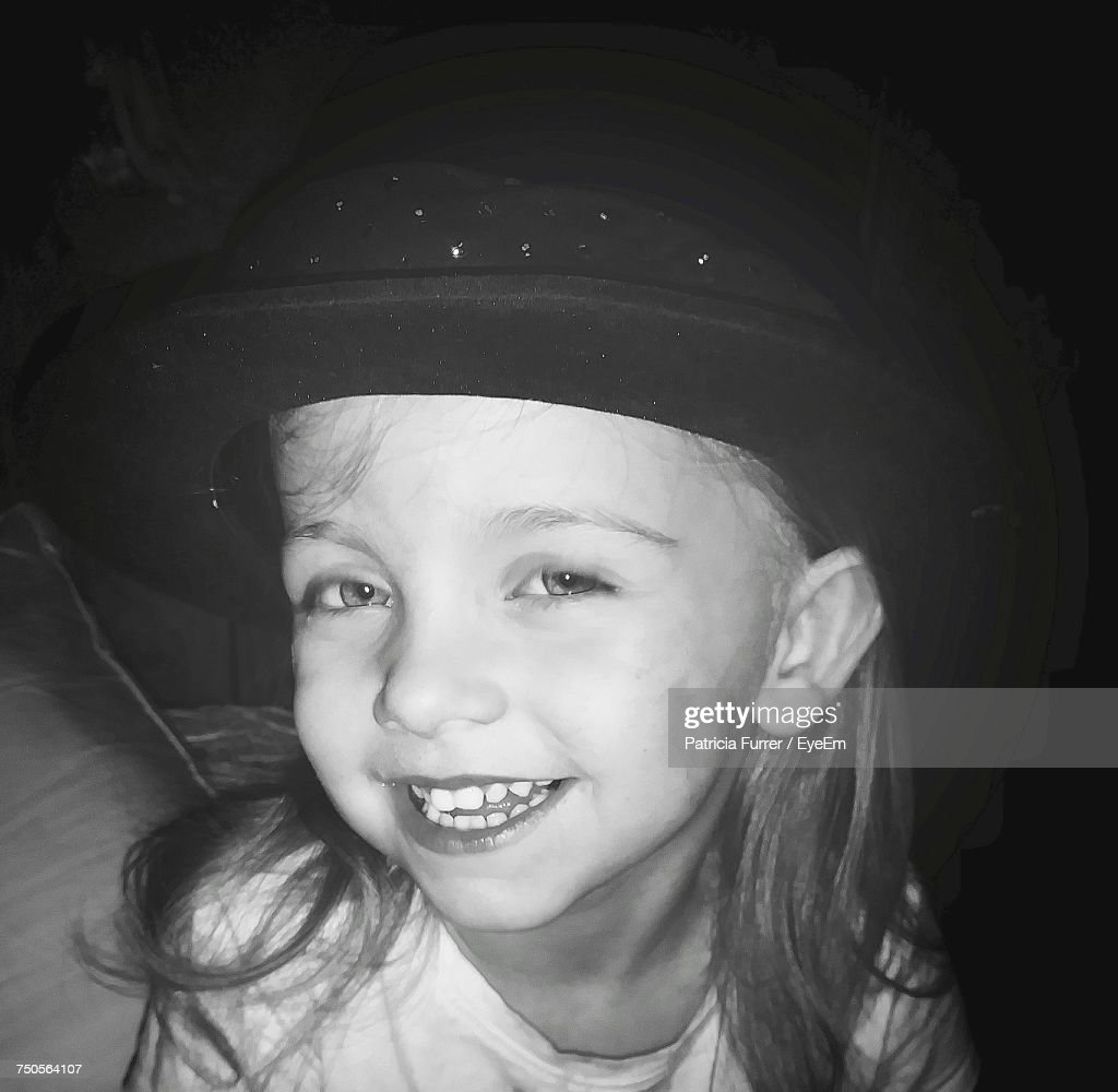 Close-Up Portrait Of Cute Girl Wearing Hat : Stock Photo