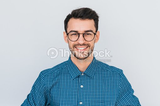 Closeup portrait of handsome smart-looking smiling with toothy smile male posing for social advertisement, isolated on white background with copy space for your promotional information or content. : Stock Photo