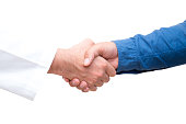 Closeup portrait of healthcare professional doctor shaking hand with patient, isolated on white background.