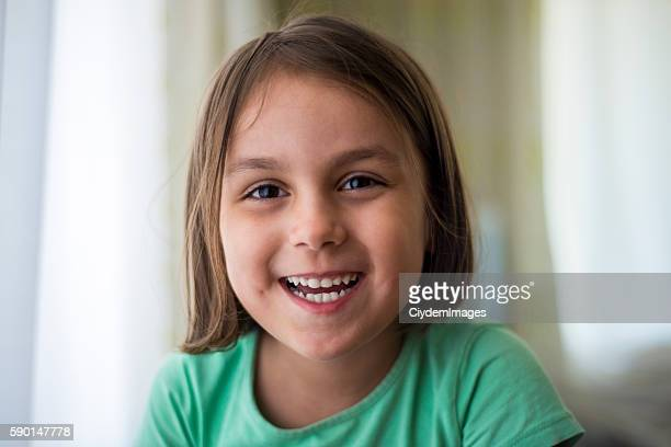 Close-up portrait of laughing little girl