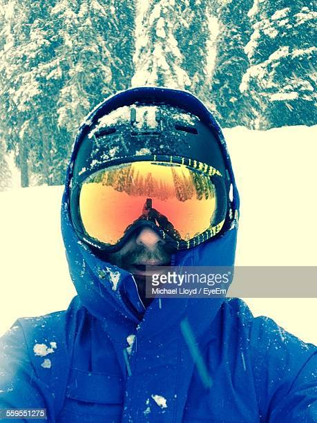 Close-Up Portrait Of Man On Snowcapped Mountain During Winter