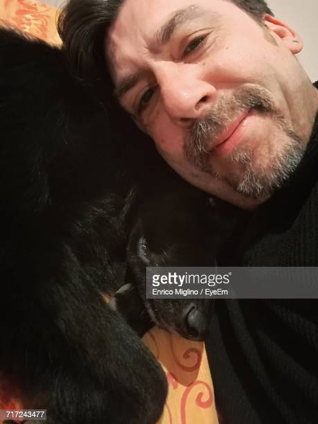 Close-Up Portrait Of Man With Dog