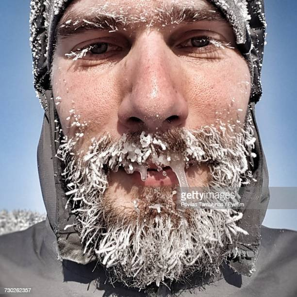 Close-Up Portrait Of Man With Frozen Beard And Mustache