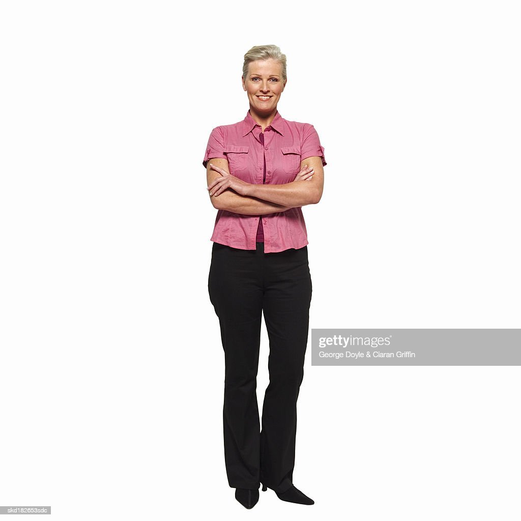 Close-up portrait of mature woman with arms crossed : Stock Photo