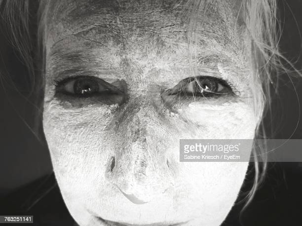 Close-Up Portrait Of Mature Woman With Flour On Face