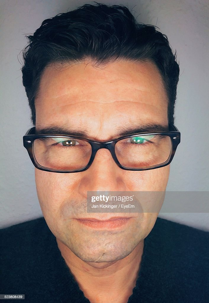 Close-Up Portrait Of Mid Adult Man Wearing Glasses
