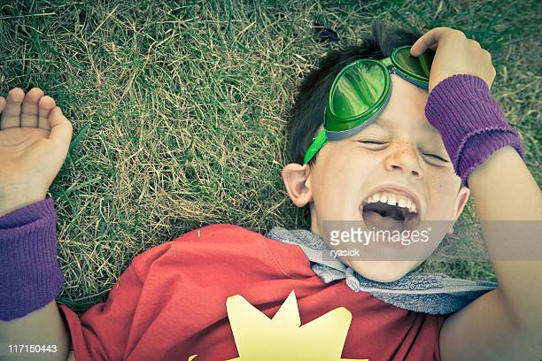 Closeup Portrait of Playful Laughing Costumed Superhero Boy Having Fun