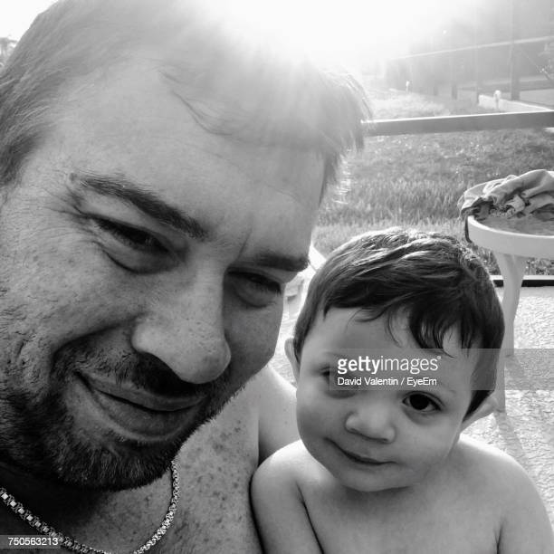 Close-Up Portrait Of Shirtless Father And Son