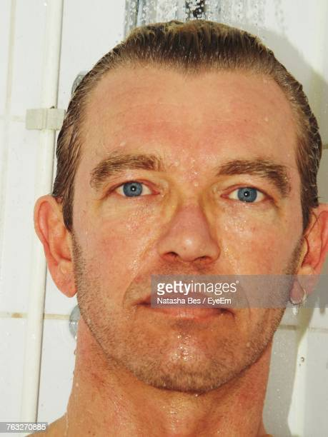Close-Up Portrait Of Smiling Man In Shower