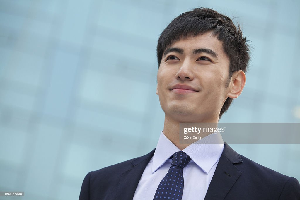 Close-up portrait of young businessman, China : Stock Photo