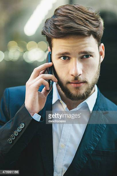 Closeup portrait of young businessman talking on the phone
