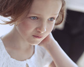 Close-up portrait of young girl looking away from camera