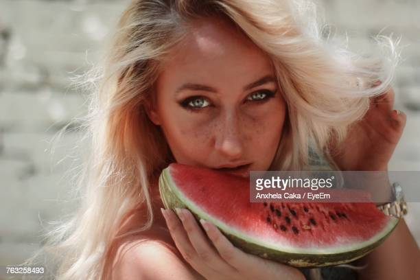 Close-Up Portrait Of Young Woman Eating Watermelon
