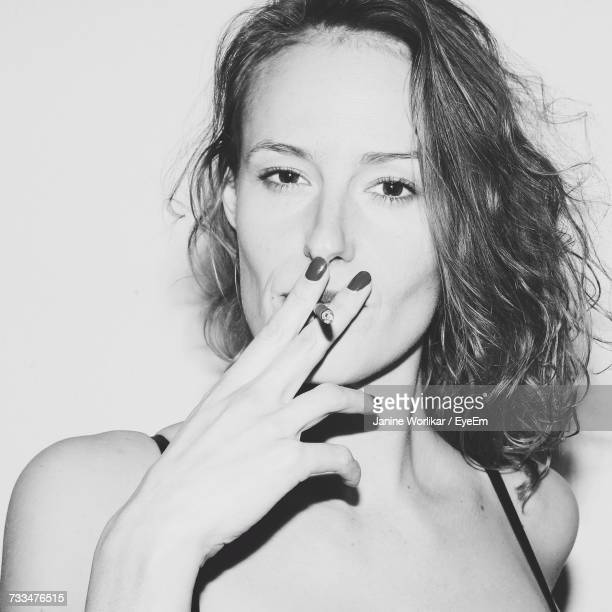 Close-Up Portrait Of Young Woman Smoking