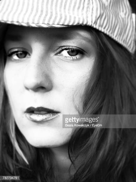 Close-Up Portrait Of Young Woman Wearing Flat Cap