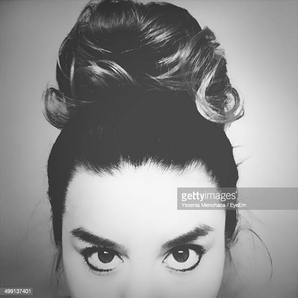 Close-up portrait of young woman with hair bun