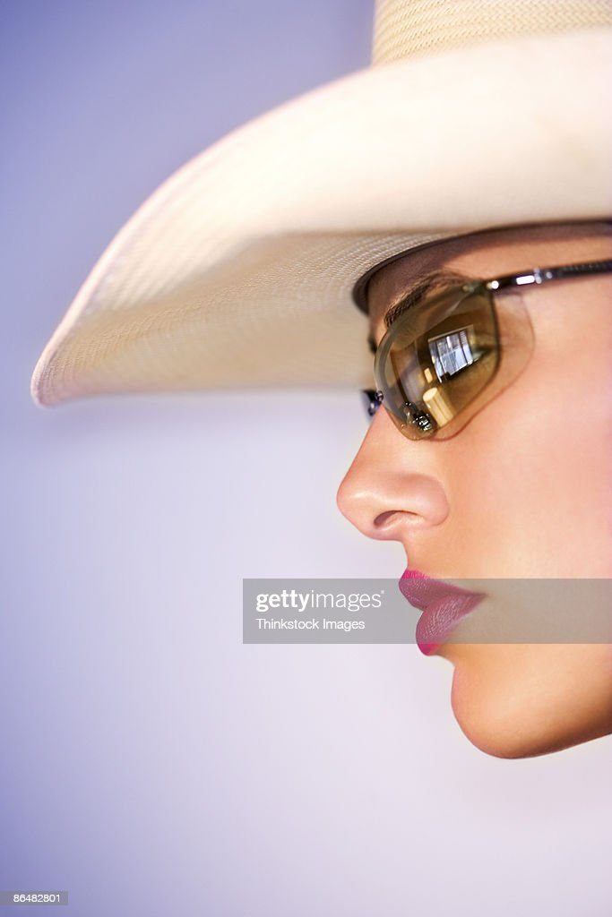 closeup profile of woman wearing a cowboy hat and