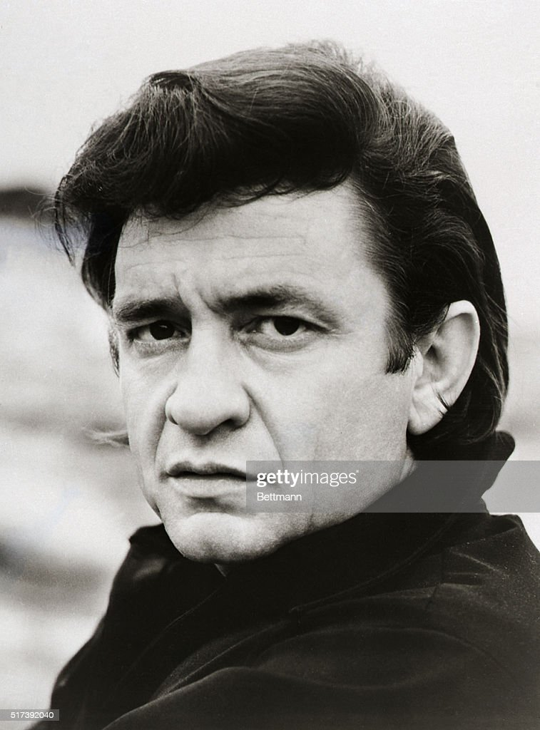 Close-up publicity portrait of singer Johnny Cash.