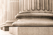 Closeup bases of classical columns. Symbols of integrity, stability, and trustworthiness, full frame horizontal composition with copy space