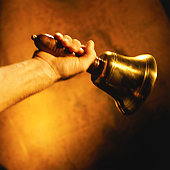 Close-up shot of a hand holding a bell