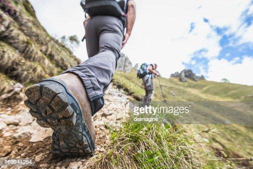 Closeup shot of a hiker's leg on mountain trail