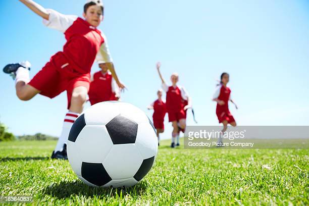 Closeup shot of children playing soccer
