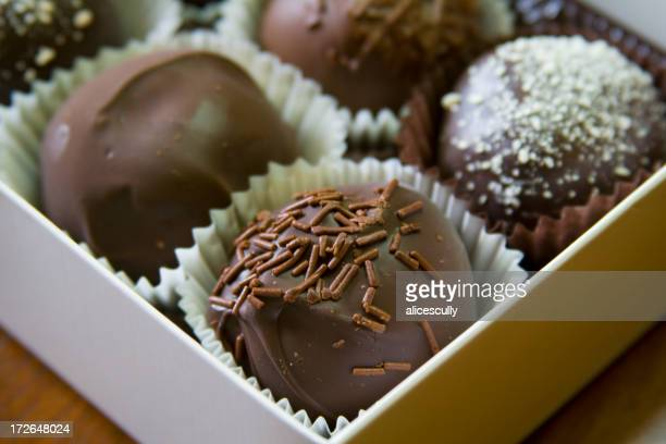 Close-up shot of chocolate truffles in a gift box