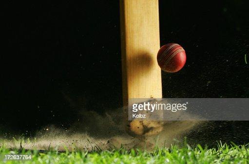 Close-up shot of cricket bat hitting ball