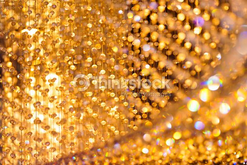 Close Up Shot Of Crystal Chandelier Decoration With Golden Light Bokeh Background Stock