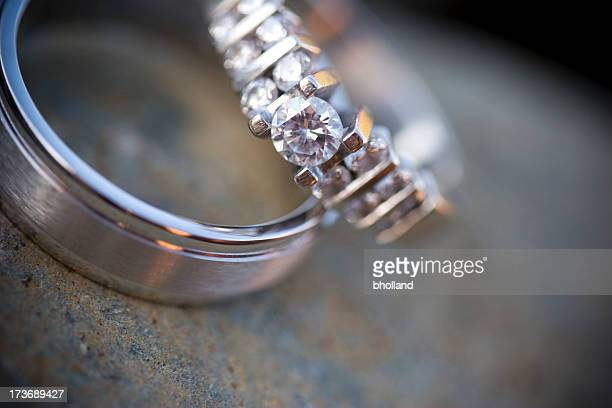 Close-up shot of diamond wedding ring and wedding band