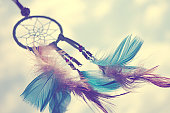 Close-up shot of dream catcher with colored feathers