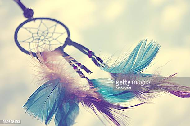 Close-up shot of dreamcatcher with colored feathers