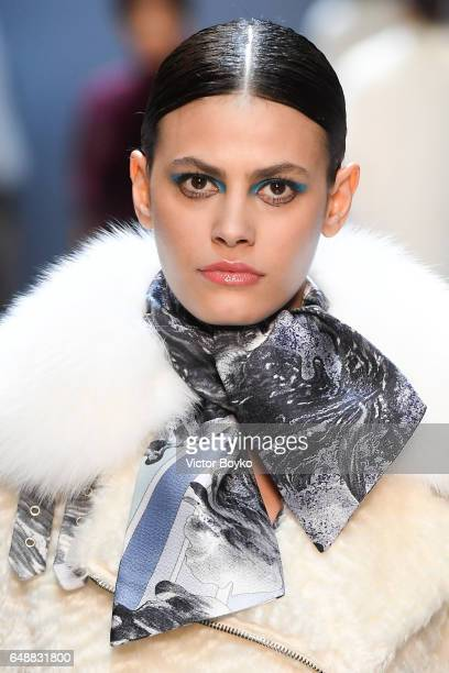 A closeup shot of model Alisar Ailabouni walking the runway during the Leonard Paris show as part of the Paris Fashion Week Womenswear Fall/Winter...