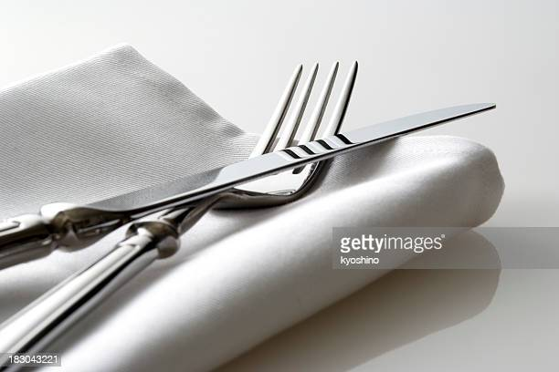 Close-up shot of silverware on white napkin