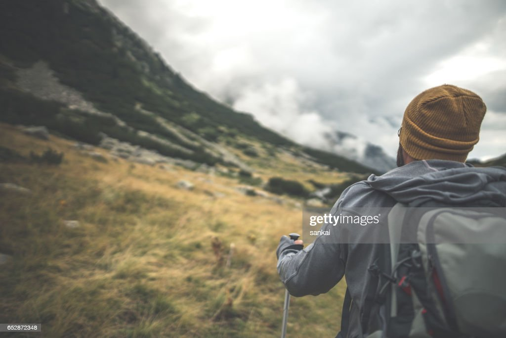 Close-up shot of traveler walks alone in mountains : Stock-Foto