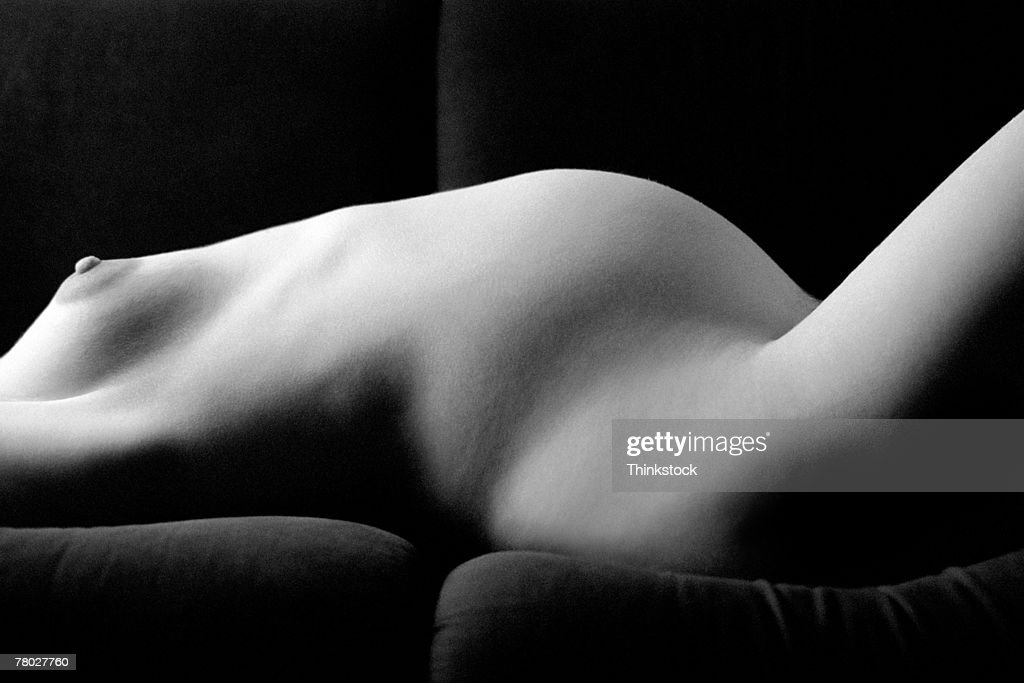 nude pregnant in the sofa
