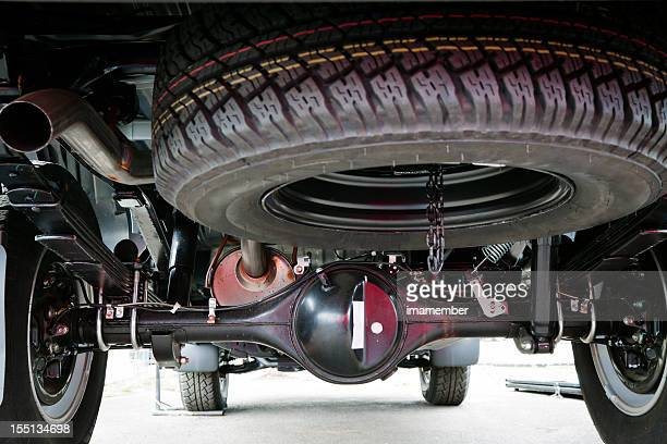 Closeup small truck spare tyre attached under the vehicle