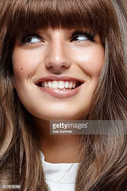 Closeup smiling young woman