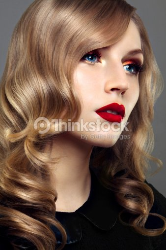 Close Up Portrait Of Beautiful Woman With Bright Make Up And Curly