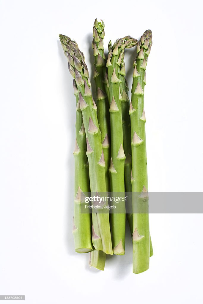 Close-up studio shot of green organic asparagus