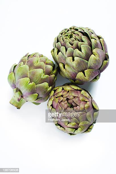 Close-up studio shot of organic artichokes