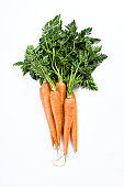 Close-up studio shot of organic carrots
